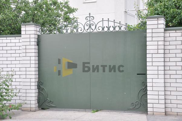 Фото металлических ворот с ковкой
